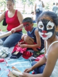 Face painted children being artistic